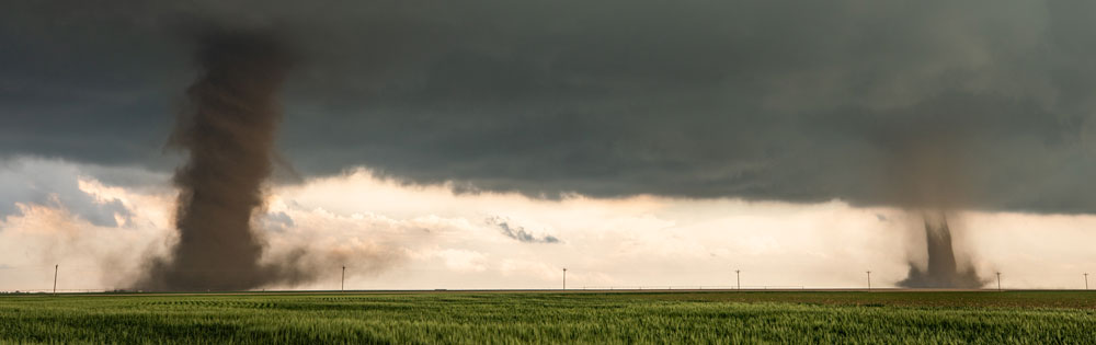 Michael Charnick's photo of twin landspout tornadoes in the high plains of Flagler, Colorado.